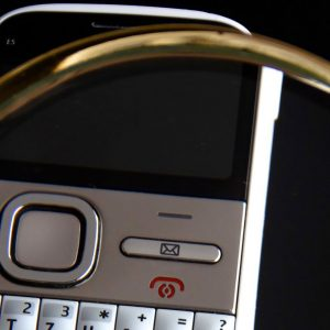 A magnifying glass and a mobile phone, showing Accessible Design